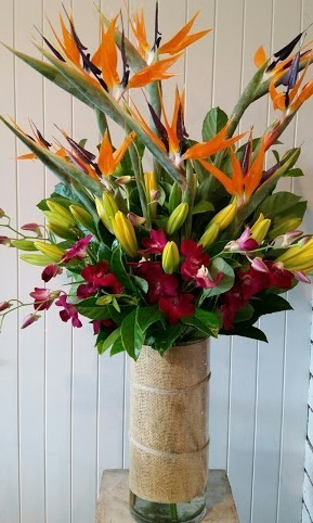 birds of paradise and purple orchids corporate reception arrangement
