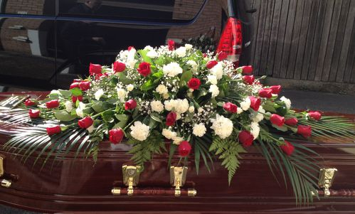 Red Rose and White Carnation Casket Flowers with Tropical Leaves