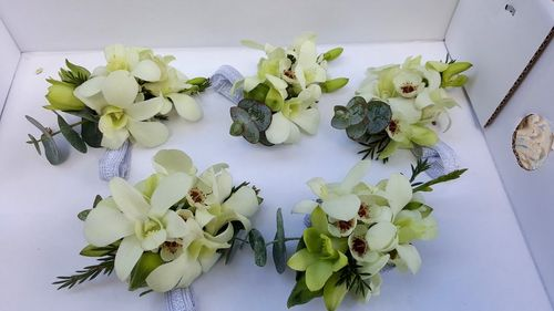 Wrist Corsages with White Orchids