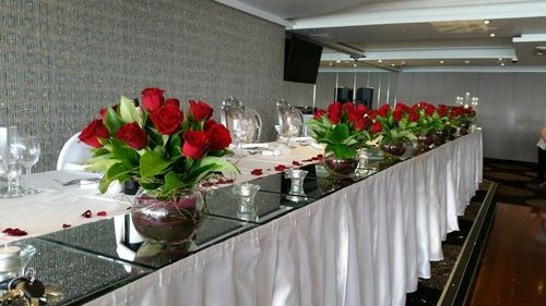 Red Rose Vase Arrangements with Red Petals for your Bridal Table