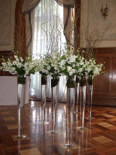 Tall Vase Arrangements with White Orchids and Twisted Willow