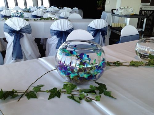 Guest Table Arrangements with Blue Orchids and Ivy