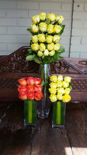 Colourful Columbian Roses in Tall Vases